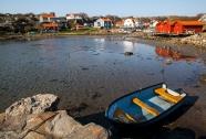 Blue Boat in Bay